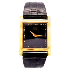 18 Karat Piaget Tank Watch Yellow Gold with Black Leather Band
