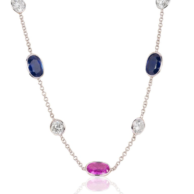 18k Neckalce with 3 pink sapphires weighing 4.01 carats and 5 blue sapphires weighing 6.28 carats and 12 diamonds weighing 5.08 carats