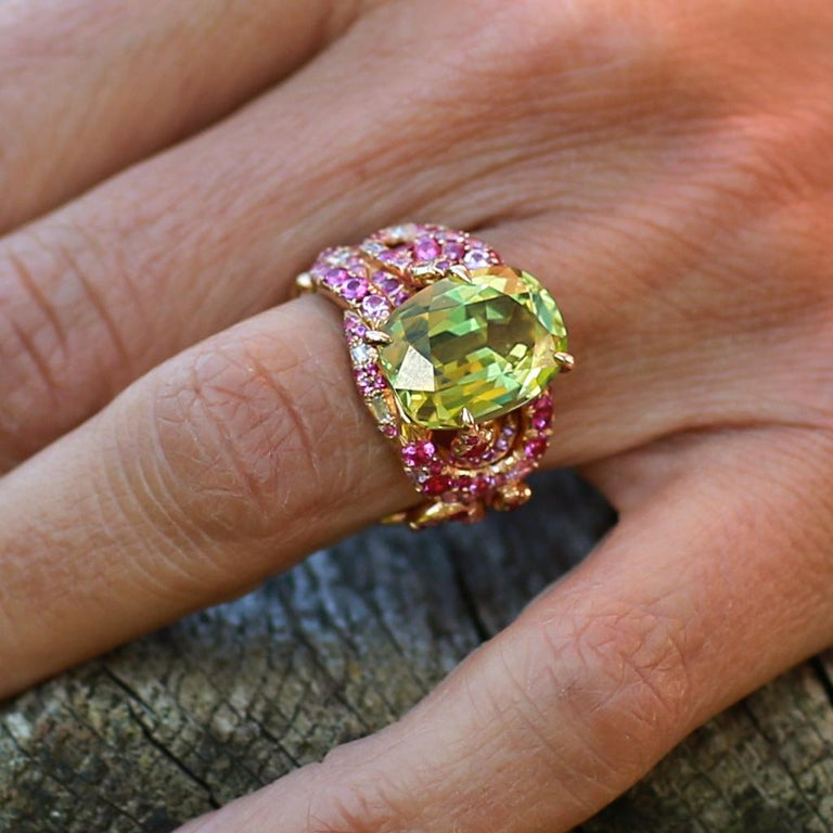 Gemstones: Chrysoberyl 10,17ct. Paving: Pink Sapphire 2,52ct., White Diamonds 0,16ct. Material: Pink Gold 750 Size: 53  Perfect untreated Tajik Chrysoberyl, Pink Sapphires and White Diamonds handcrafted in Pink Gold, partially plated with Blue