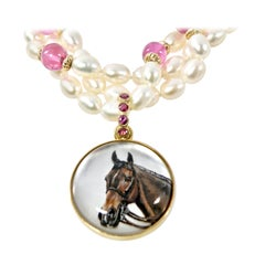 18 Karat Reverse Crystal Painted Horse Pendant with Sapphire Bail