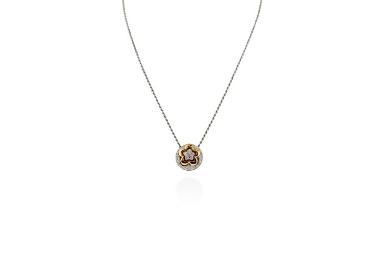 0.72 carats of G VS pave diamonds on a Floral pattern Pendant Necklace set in 8.8 grams of 18K white and rose gold. 15.85 mm pendant. Chain drop is 7.5 inches. Made in Italy.   Viewings available in our NYC showroom by appointment.