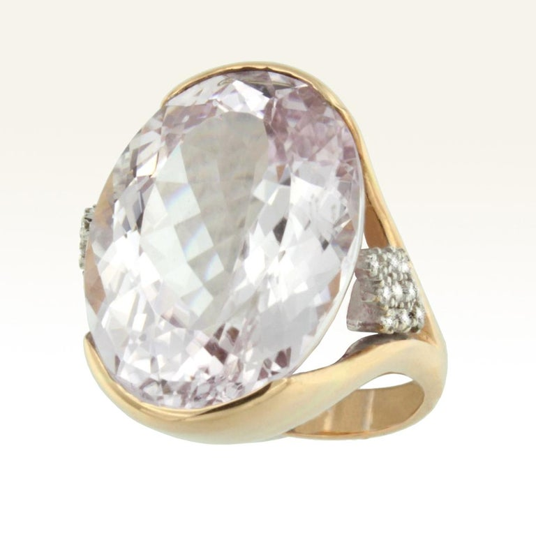 Ring in 18k white and rose gold with Kunzite (oval cut, size: 16x22 mm; carats 25,75 ) and Diamonds karat 0.20 VS colour G/H   g.14.80 Kunzite is the perfect stone for those who sometimes can't resist emotions, bright pink color. Amazing cocktail
