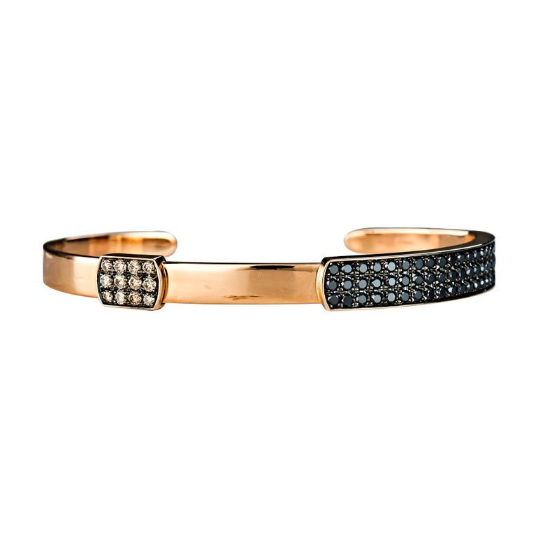 Inspired by the defenders of mighty castles and ancient armours the Guard of Men collection presents bold angles and oxidized color tones. The limited edition collection is handcrafted using 18 Karat Gold and Silver.    This 18 Karat Rose Gold