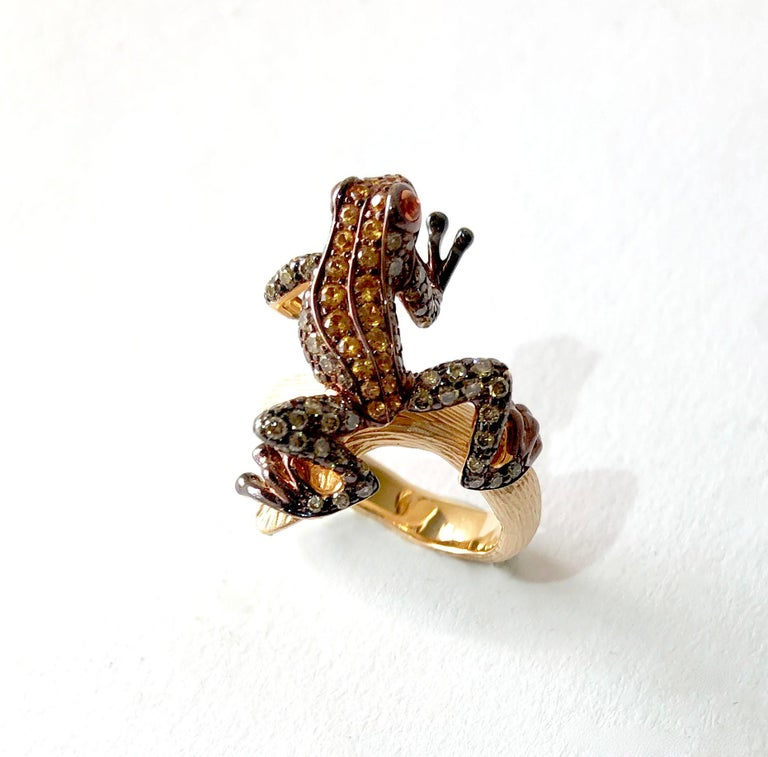 18k rose gold leaping frog ring encrusted with natural gemstones, maker unknown.  Ring is a finger size 6.5 and is signed 750 on the inside shank.  In very good vintage condition.  13.1 grams.