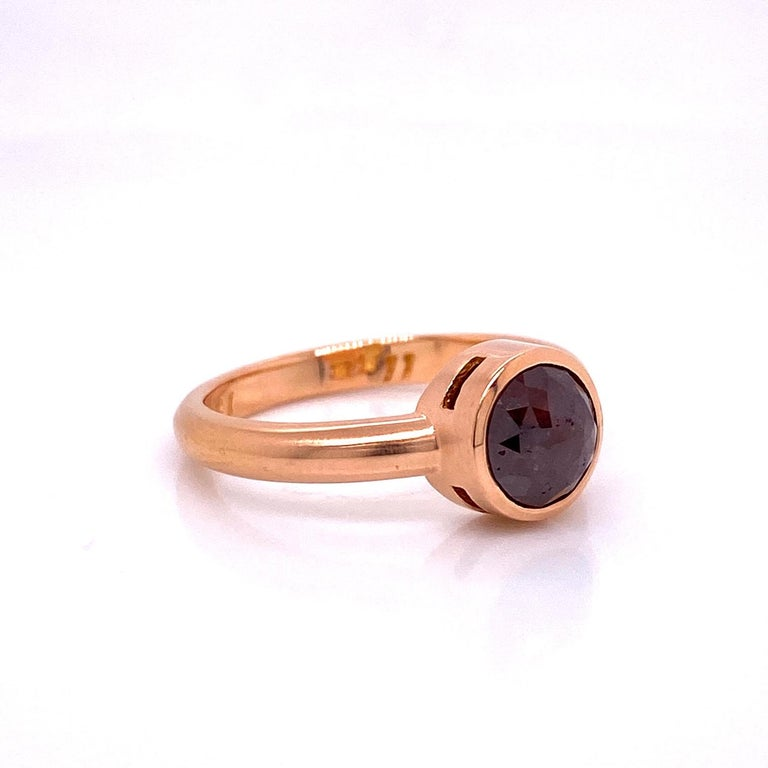 An 18k rose gold ring bezel set with a 3.12 carat round red brown rose cut diamond with a brushed finish. Ring size 7. Designed and made by llyn strong.