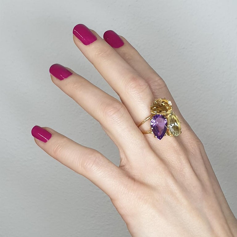 Intertwining of the same shapes with different colors create a very trendy Ring, Italian art jewels by Stanoppi Jewellery since 1948.  Ring in 18k rose gold with Amethyst (drop cut, size: 10x15 mm), Citrine (drop cut, size: 10x15mm) and Prasiolite