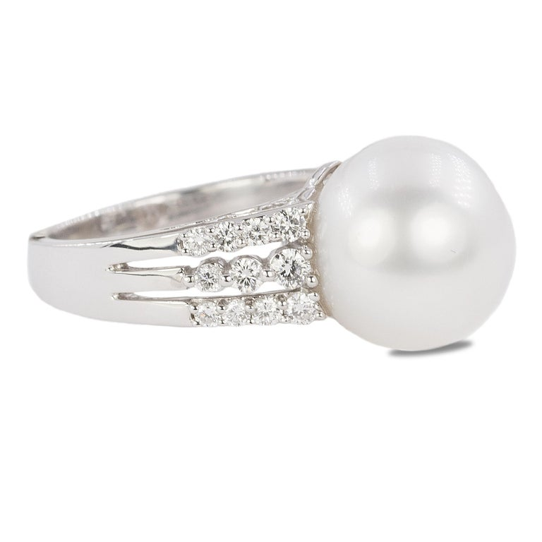 18k White gold ring with 13mm South Sea pearl and 22 round brilliant diamonds weighing approximately 0.50 carats.