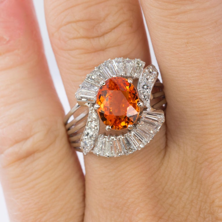 Oval Cut 18 Karat Spessartite Garnet and Diamond Ring For Sale