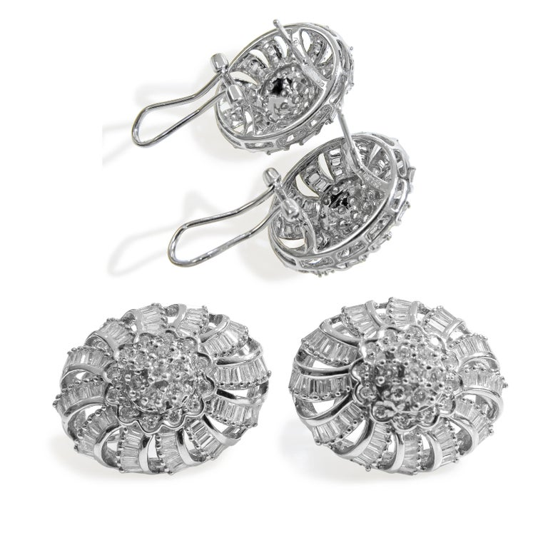 18k White Gold  Weight= 24 gr  Ring Diamond= 2.60 Ct total  Earring Diamond= 5. 20 Ct total  Diamond's color & Clarity = GH- VS2  Size Ring= 7  Earring and Ring size= 25mm x 20mm  Year= 1980