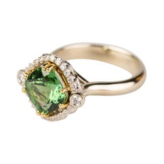 18k White and Yellow Gold 2.81 Carat Green Tourmaline Ring with a Diamond Halo