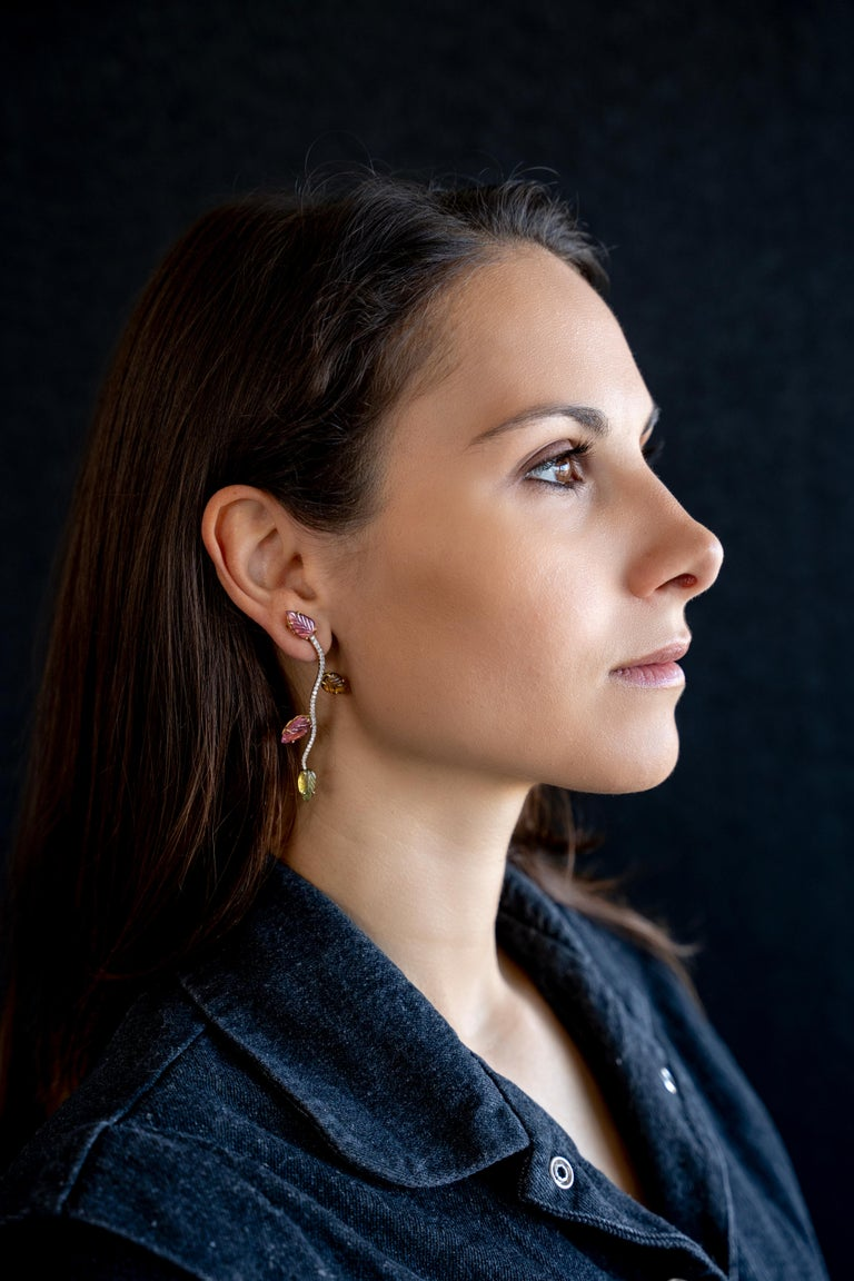 These unique earrings have been created from an original vine stalk drawing based design.  Eight engraved tourmalines weight : 8,03 carats. White diamonds weight : 0.60 carat.  18K white and yellow gold. French assay mark. Price without local taxes.