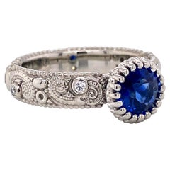 18 Karat Gold 1.09 Carat Blue Sapphire Swirl Pattern Ring with White Diamonds