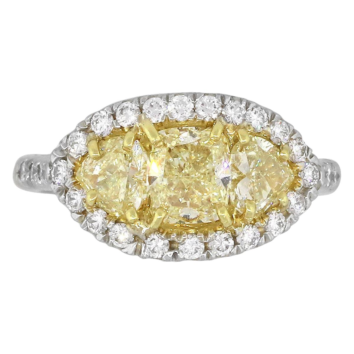 18 Karat White Gold 2.33 Carat Diamond Three-Stone Halo Ring
