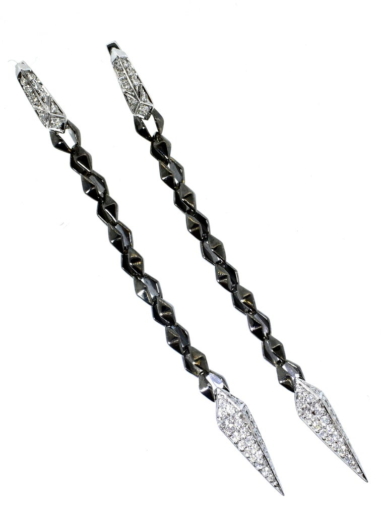 18K white gold and diamond pendant style earrings with .90 cts. of very fine white diamonds, F/G, VS, (colorless to near colorless and very slightly included), these earrings are 18K white and blackened gold.  They are 3.25 inches long.  Signed, SW