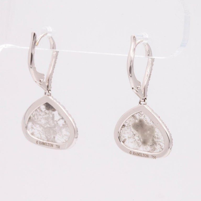 These beautiful handmade drop earrings feature two diamond slices that weigh 2.97 carats total. Accented with 74 pave set round diamonds that are also on the front on the ear wire, weighing .38cts total. G color and VS clarity. Crafted in 18k white