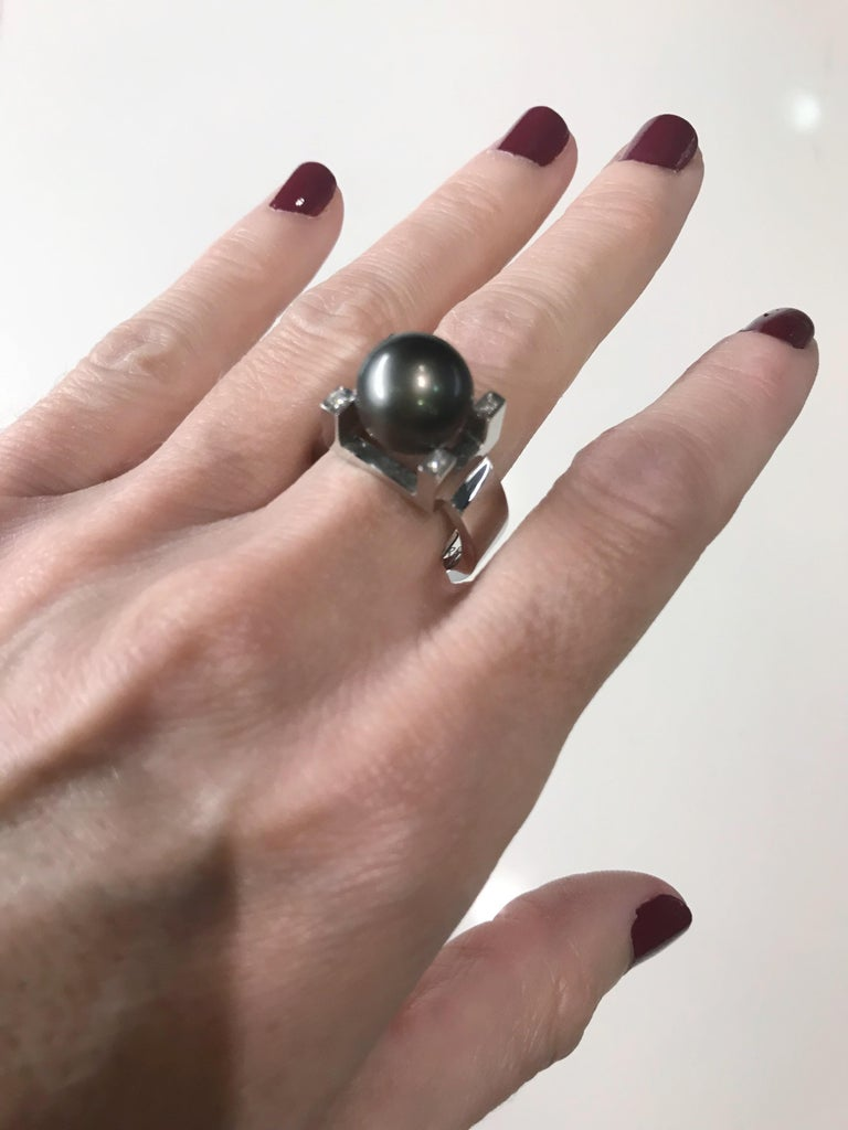 Ring in 18K White Gold, Tahitian Pearl and Four Diamonds.  Pearl Quality: AAA ( best quality)  Please indicate your Ring size when ordering.  TORRUBIA & TORRUBIA, designs sustainable fine jewelry. Sisters Amaia and Yolanda Torrubia, very sensitive