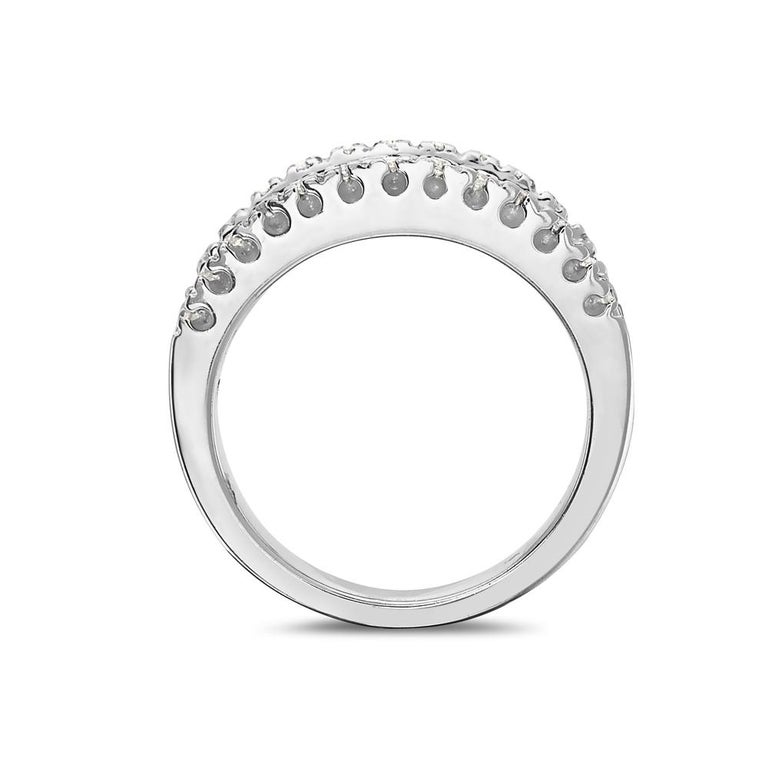This ring features 1.45 carats of pave diamonds set in 18K white gold. 11.2 grams total weight. Made in Italy. Size 7.5  Can be resized upon request.   Viewings available in our NYC showroom by appointment.