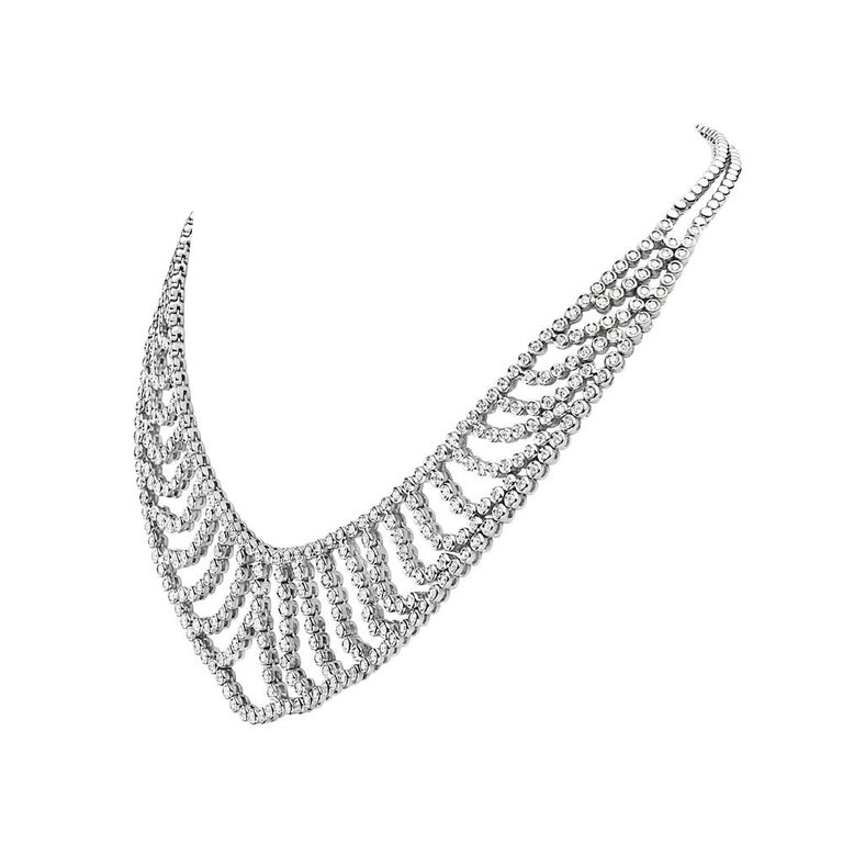 This necklace features 9.93 carats of G VS diamonds set in 18K white gold. 101.8 grams total weight. 8 inch chain drop. Made in Italy.   Viewings available in our NYC showroom by appointment.