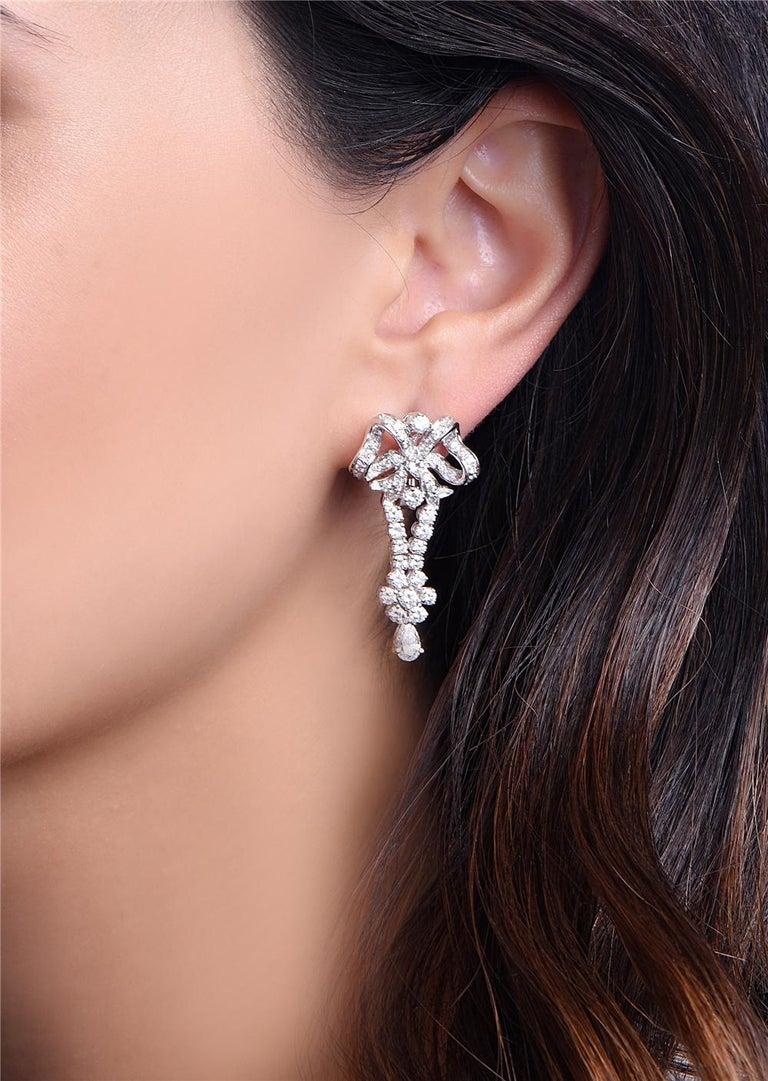 Round Cut 18 Karat White Gold Bow Drop Diamond Dangle Chandelier Earrings For Sale