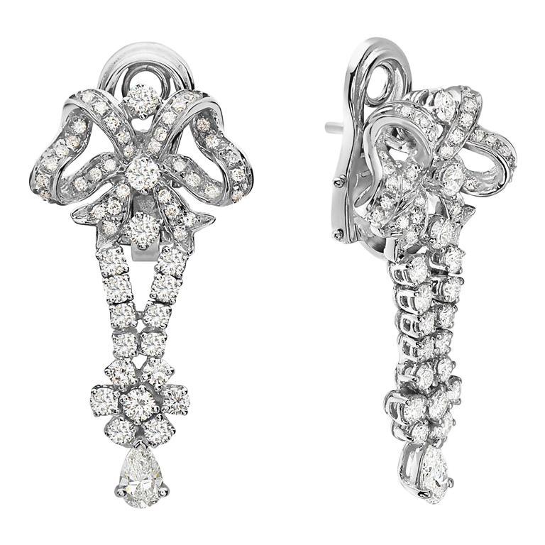 18 Karat White Gold Bow Drop Diamond Dangle Chandelier Earrings For Sale