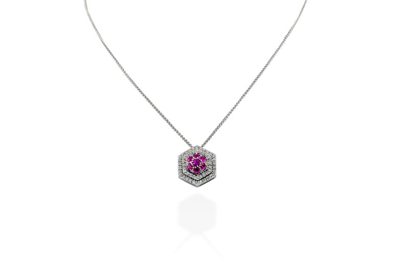 This necklace features a pendant containing 1 carat of G-H VS diamonds set alongside pink sapphires in 5 grams of 18K gold. Chain drop is approximately 8 inches. Made in Italy.    Viewings available in our NYC showroom by appointment.