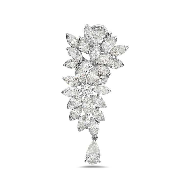 These Harry Winston style diamond chandelier earrings feature 22.70 carats of F-G VS diamonds set in 18K white gold. The 22.70 carats of diamonds are made up of 49 marquise brilliant diamonds weighing 19.8 carats, 4 round brilliant diamonds weighing