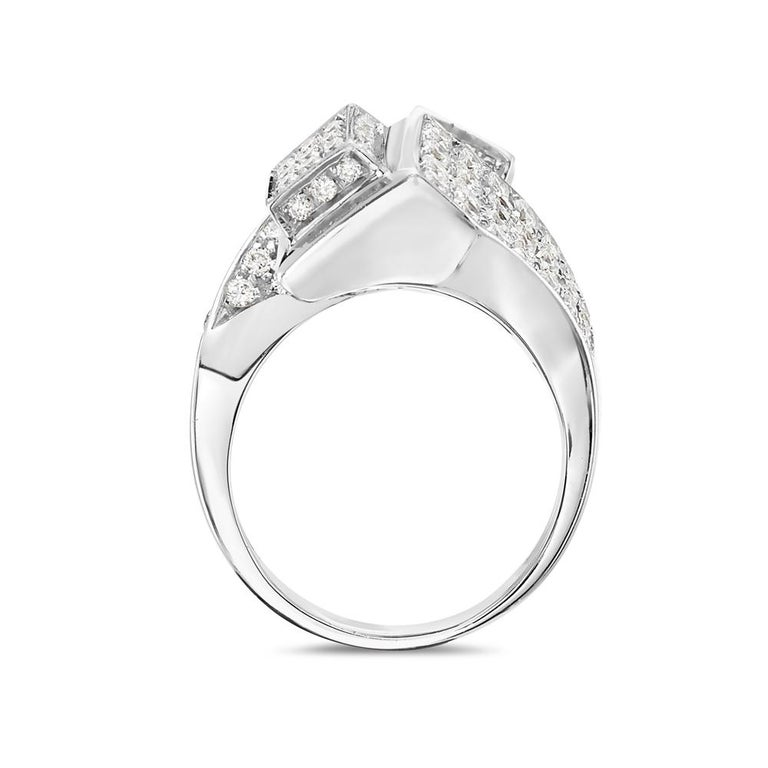 This cocktail ring features 2.38 carats of G VS pave diamonds set in 18K white gold. 17 grams total weight. Made in Italy. Size 7.5   Resizeable upon request.   Viewings available in our NYC showroom by appointment.
