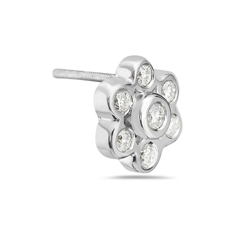 These stud earrings feature 0.45 carats of G VS diamonds set in 18K white gold. 2.7 grams total weight. Made in Italy.  Viewings available in our NYC showroom by appointment.