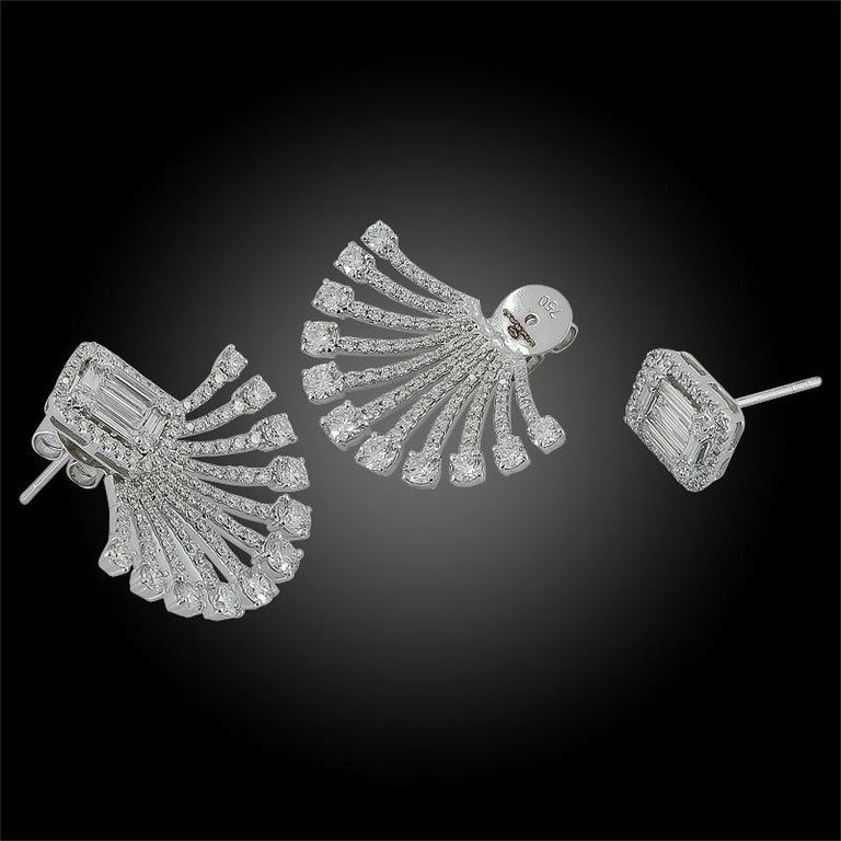 A pair of 18k white gold diamond illusion style setting earrings with detachable studs. Diamonds weighing approximately 3.45 cts.