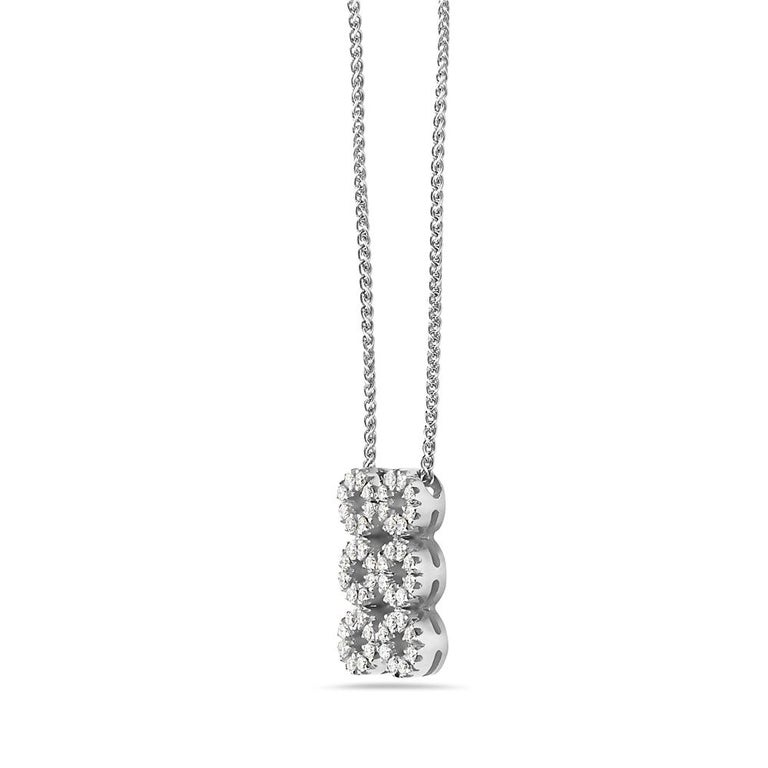 This pendant is encrusted with 0.56 carats of G VS diamonds set in 18K white gold. 6 grams total weight. 8 inch chain drop. Made In Italy.  Viewings available in our NYC showroom by appointment.
