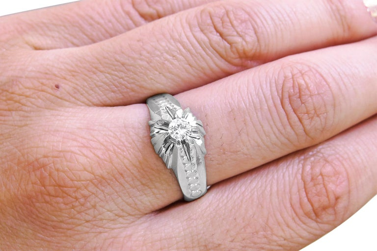 18K White Gold  Weight= 6.3gr  Diamond= 0.35 Ct total  Diamond's color & Clarity = GH Year= 1980