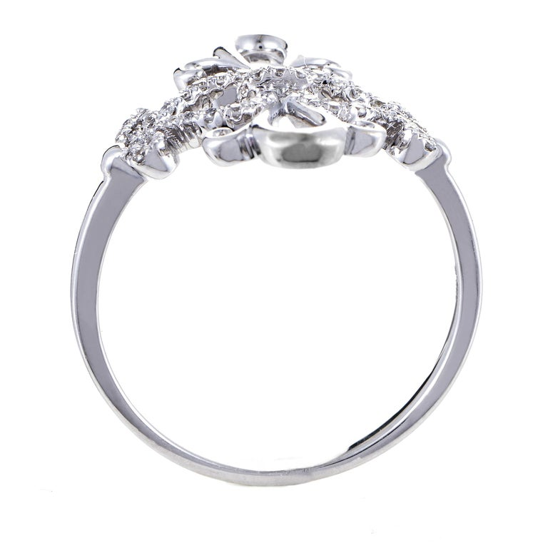 Delightful and irresistibly graceful décor combines the smooth flow and immaculate gleam of 18K white gold with prestigious resplendence of diamonds totaling 0.24ct in this fascinating and wonderfully harmonious ring.<br />Ring Top Dimensions: 17 x