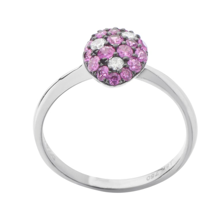 A gorgeous blend of romantic rubies weighing in total 0.55ct and glittering diamonds amounting to 0.09ct is placed upon a splendid 18K white gold body in this remarkably tasteful ring.<br />Ring Size: 8 x 10mm