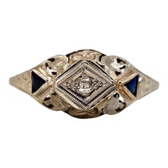 18 Karat White Gold Engraved and Pierced Oval Diamond and Sapphire Ring