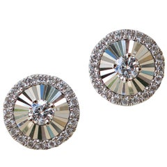18 Karat White Gold Fan Style Stud Earrings Are Set with 0.19 Carat of Diamond