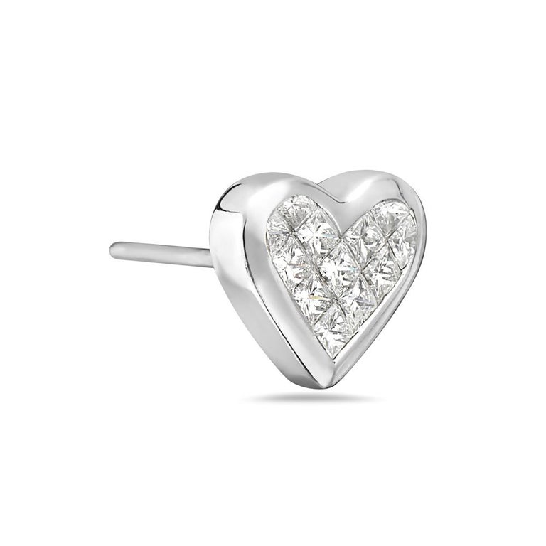 These heart shape earrings feature 1.0 carats of G VS channel set princess cut diamonds set in 18K white gold. 5.1 grams total weight. Post back for pierced ears. Made in Italy.   Viewings available in our NYC showroom by appointment.