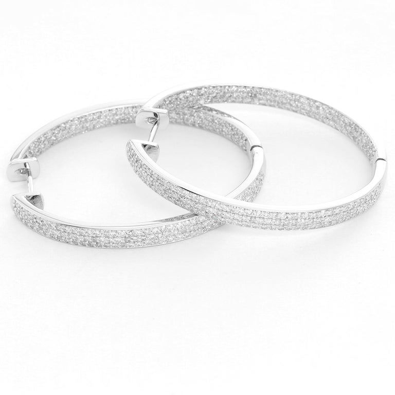 2.80 cts of Pave diamonds on 18K White Gold. They are the perfect earrings, they are light and do not bring your ear down.  Total length 1.5 inches. Total weight 13.6 grams