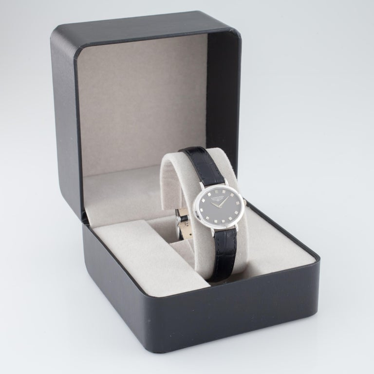 Movement #312 Movement Serial #14223859 Case #40815 18k White Gold Oval Case 28 mm Wide (29 mm w/ Crown) 24 mm Long Lug-to-Lug Distance = 30 mm Lug-to-Lug Width = 12 mm Thickness = 5 mm Slate Gray Dial w/ Silver Tic Marks and Hands (M + H) 24 mm