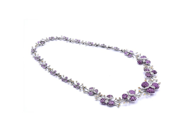 Designer: custom designed Material: 18k white gold Sapphires: round cut green, pink, and yellow sapphires Dimensions: necklace is 16-inches in length Weight: 42.15 grams