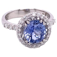 18k White Gold Pastel Blue Sapphire Ring with a White Diamond Halo