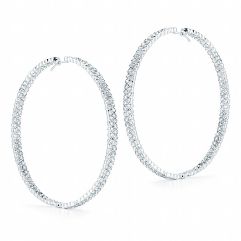 These hoop earrings feature round brilliant cut diamonds in 2 row settings.  345 round brilliant-cut diamonds sparkle mightily from these gorgeous and glamorous white gold and diamond hoops, measuring 2.5 inches in length. The hoops dance and dazzle