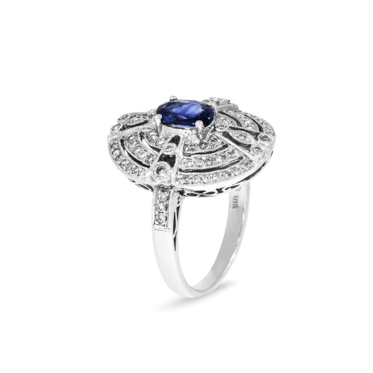 Modern 18 Karat White Gold Ring with 78 Diamonds and Sapphire For Sale