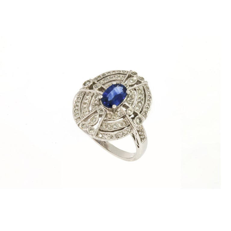 Brilliant Cut 18 Karat White Gold Ring with 78 Diamonds and Sapphire For Sale