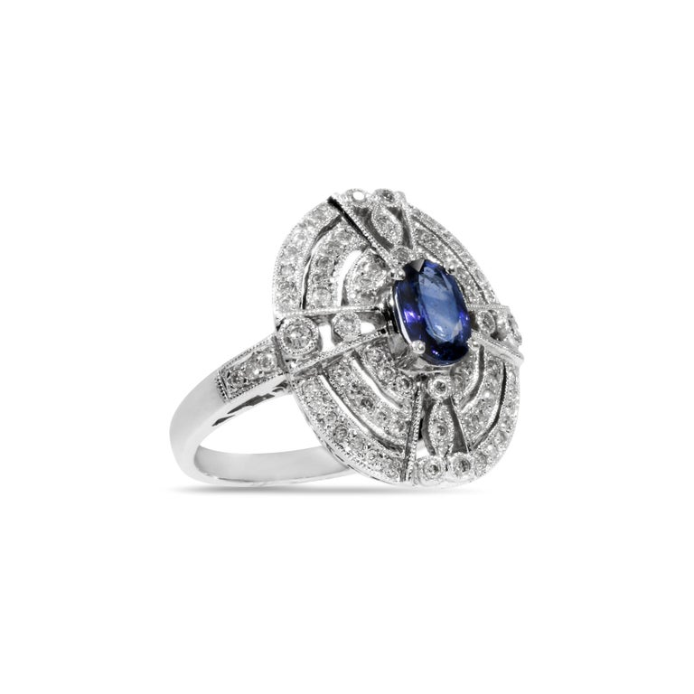 18 Karat White Gold Ring with 78 Diamonds and Sapphire In Excellent Condition For Sale In Porto, PT