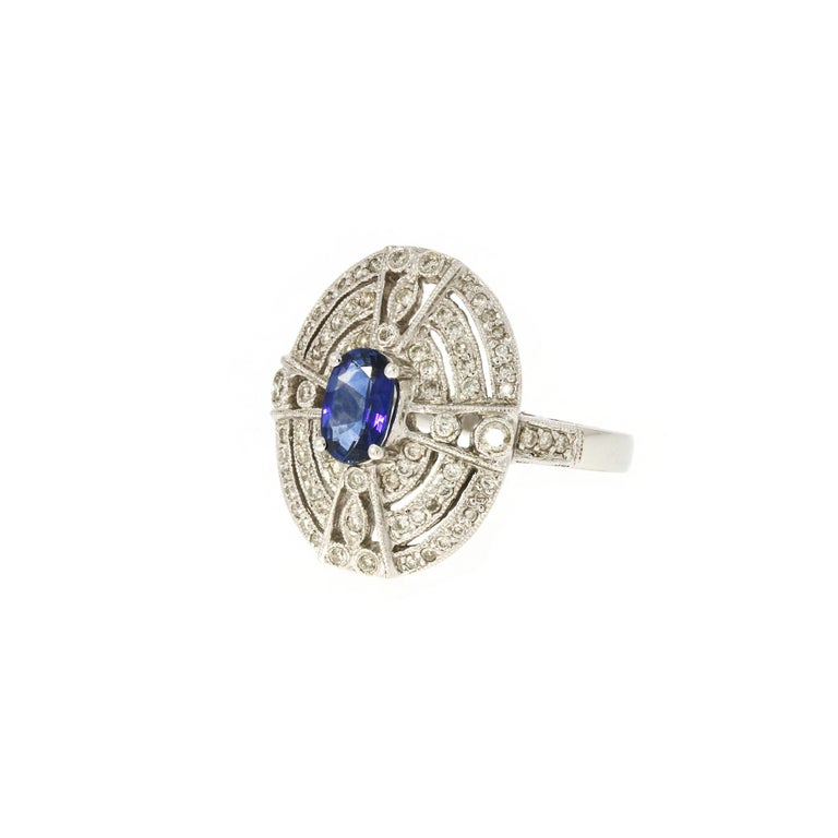 Women's 18 Karat White Gold Ring with 78 Diamonds and Sapphire For Sale