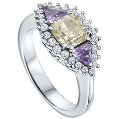 18 Karat Gold Ring with Natural Fancy Yellow Diamond and Sapphire 1.03 Carat GIA
