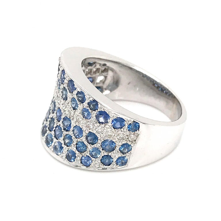 18k White Gold Sapphire: 2.0 ct twd (estimated) Diamond: 0.20 ct twd Ring Size: 6.5 Total Weight: 12.7 grams