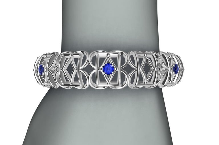 18k White Gold Sapphire Rectangle Rhombus Bangle, from the Gates series. This bracelet is inspired from hand wrought ironwork off balconies, windows, and gates in Europe. A modern twist with 7 Ceylon color diamond cut sapphires,  2.8 carats  Made to