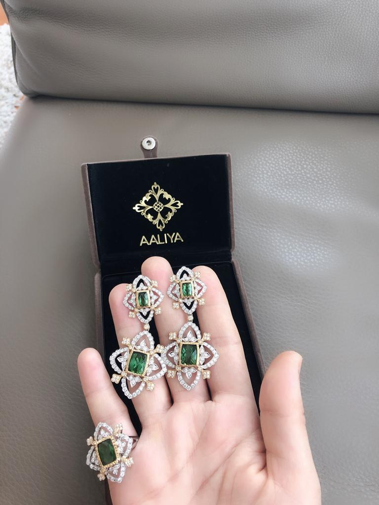 The best kind of statement earrings. These completely authentic earrings are a timeless classic that will age well and be cherished for generations. The unexpected curves, the exquisite cut pair of Afghan tourmalines, the elegantly executed hand