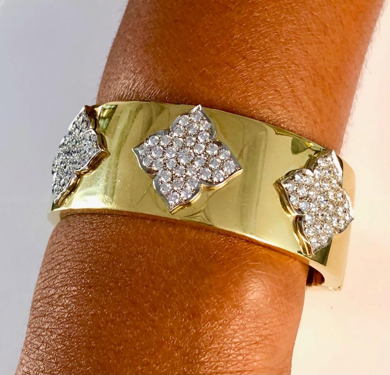 Very wide modern Bangle Bracelet made in 18K Yellow Gold and White gold Diamond crests, set with 99 round Diamonds 4.38 carats. The Bracelet has a push-button clasp to make it easy to open, another unique design feature we implemented with our